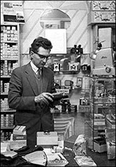 William R Hart inhis camera shop during the late 1950's